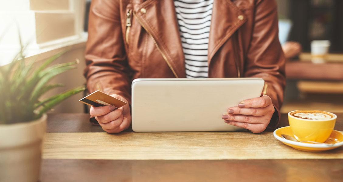 woman typing on ipad
