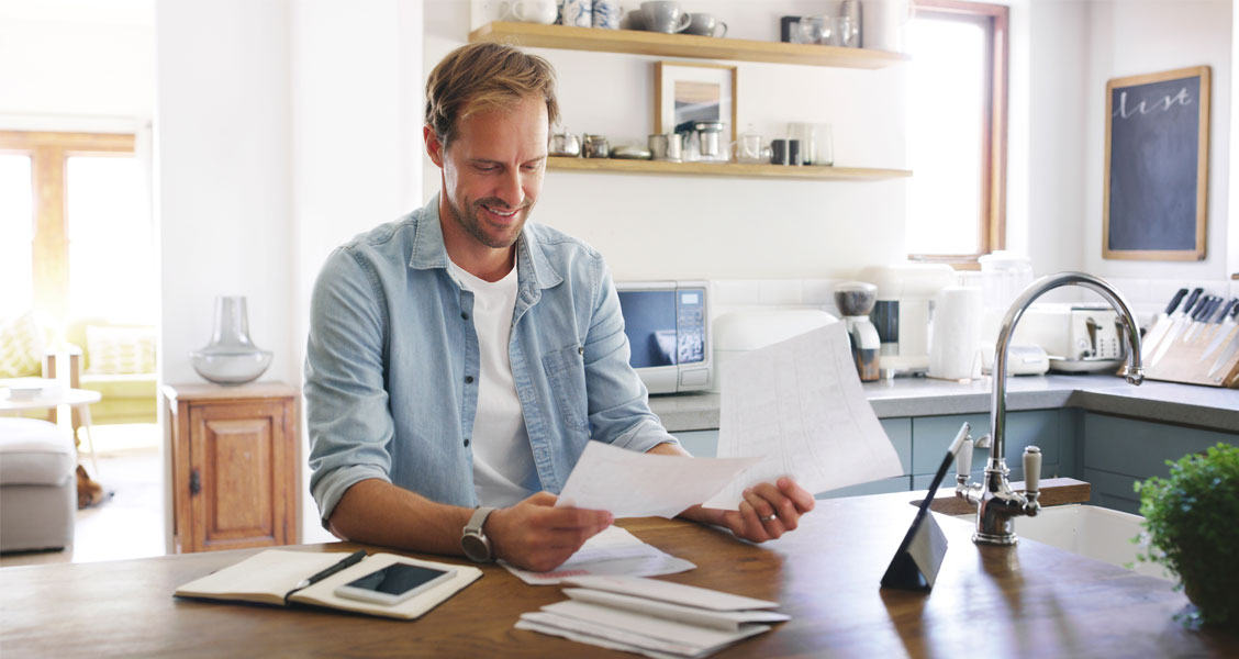 Man looking at documents and smiling