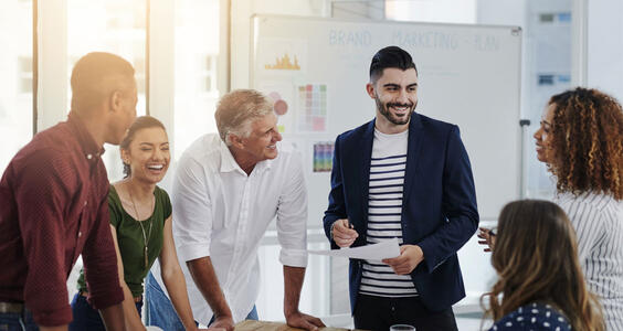 Group of people talking in office